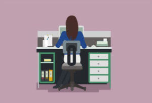 Lady at desk managing IVF in workplace